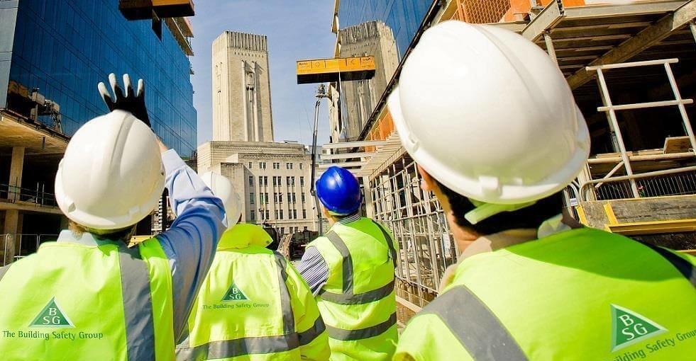 Building contractors looking at a building